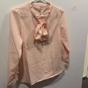NWOT peach top with pearl button